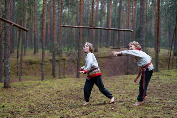 children throwing spear