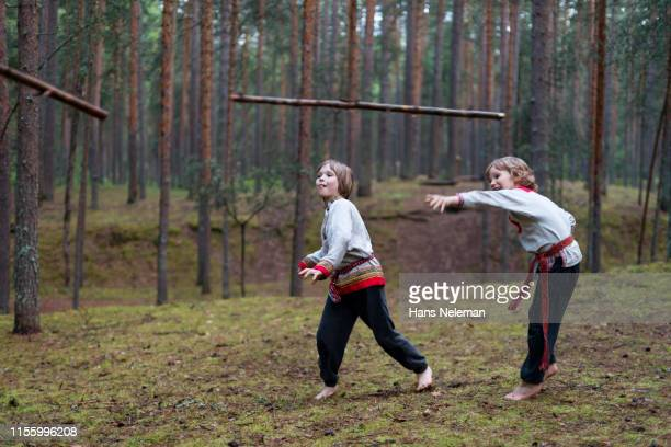 children throwing stick - spear stock pictures, royalty-free photos & images