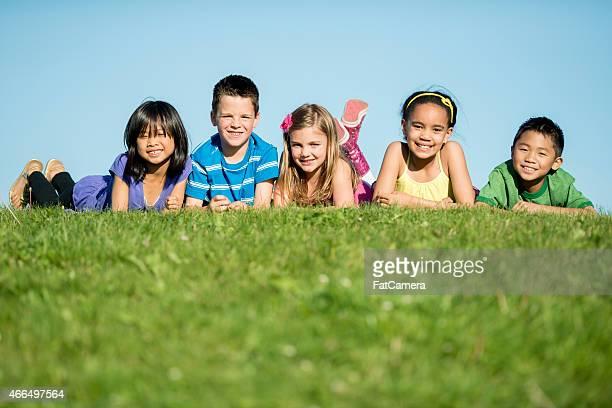 Children Together on Grass