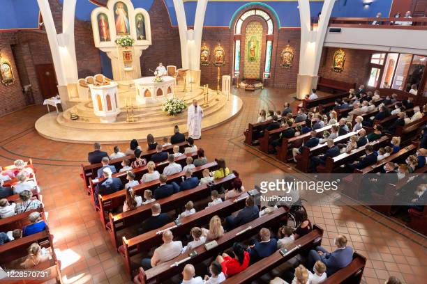 Children, together with their parents celebrate a postponed sacrament of the first communion during Coronavirus pandemic in Tychy Poland on September...