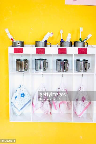 children toothbrush and toothpaste in kindergarten