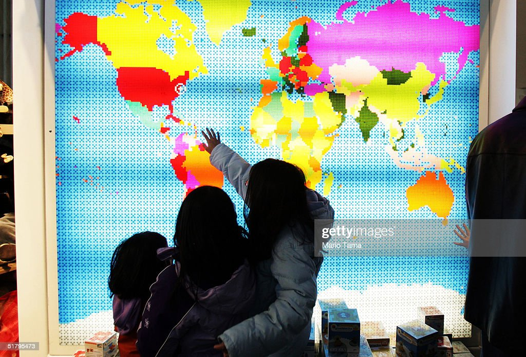 Children touch a lighted map of the world inside FAO Schwarz the day after its grand re-opening November 26, 2004 in New York City. The Friday after Thanksgiving, called 'Black Friday,' is one of the busiest shopping days of the year with stores opening early and a large number of shoppers looking for holiday gifts.