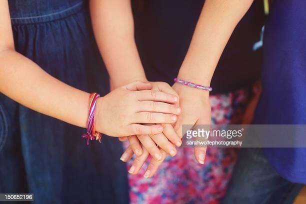 Children touching hands