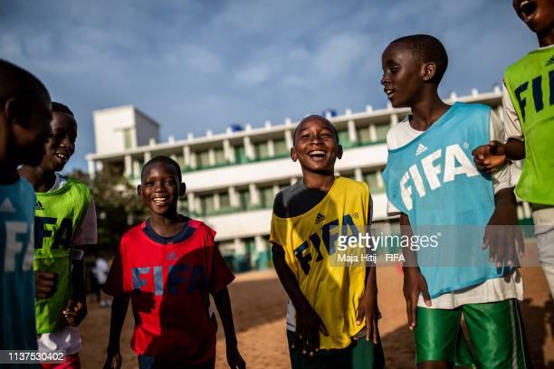 Children train during a FIFA Grassroots schools program on January 17 2019 in Dakar Senegal