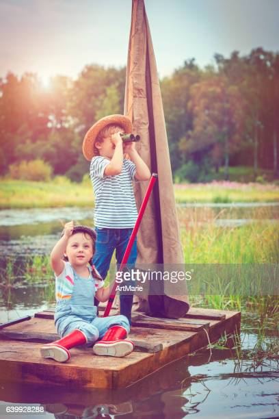 children traveling on raft - children only stock pictures, royalty-free photos & images