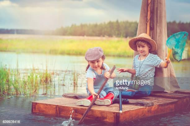 Children traveling on raft
