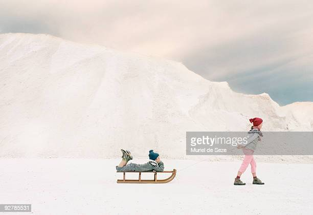 Children traveling on sledge