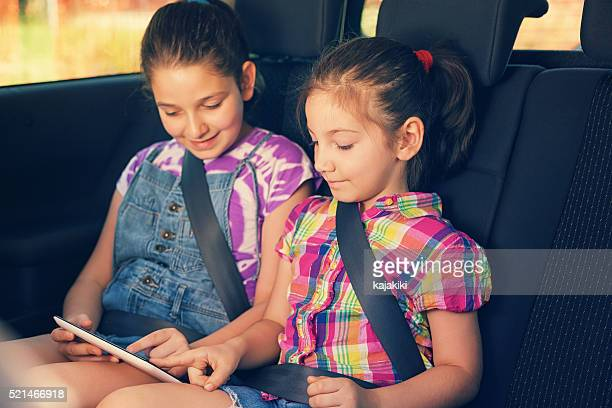 Children Travelling in Car With Tablet