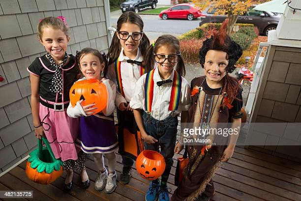 children trick-or-treating for halloween - cheerleader up skirt stock photos and pictures