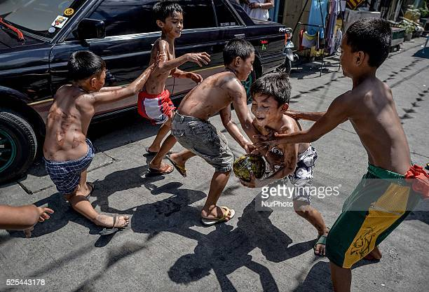 Children try to grab a coconut during parlour games as part of the feast day of Saint Rita of Cascia in Paranaque Metro Manila Philippines May 18...
