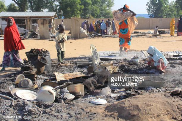 Children try to salvage valuables from burnt house following multiple attacks by Boko Haram Islamists at Dalori and other neighbouring villages...