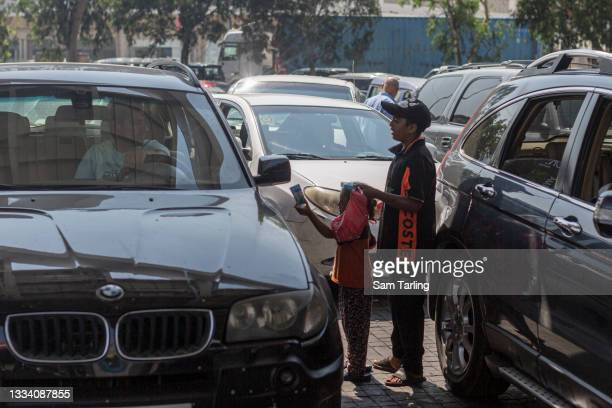 Children try to sell tissues to motorists who had been queuing for hours to fill up due to fuel shortages, at a petrol station in Beirut, Lebanon, on...