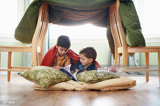 children under a homemade fort - fortress stock pictures, royalty-free photos & images