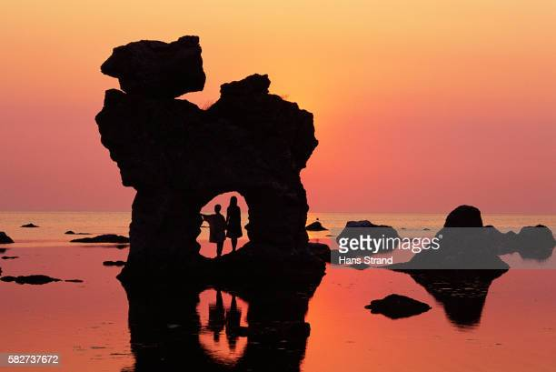 children under sea stacks - gotland stock pictures, royalty-free photos & images
