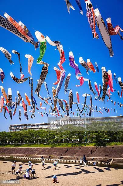 children under the many carp banners - 鯉のぼり ストックフォトと画像
