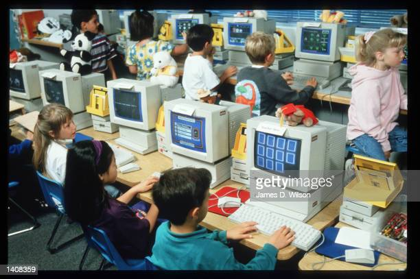 Children use Apple Computers in their classroom June 1994 in San Francisco CA Apple Computer Inc designs manufactures and markets personal computers...