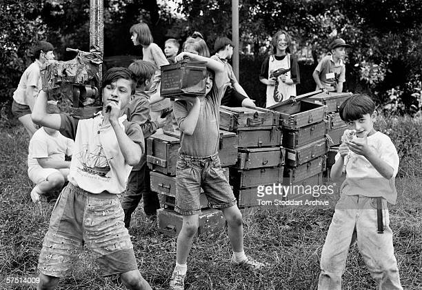 Children use empty amunition boxes as they play Serb against Bosnians during a break in the real life shelling of Sarajevo of 1992.