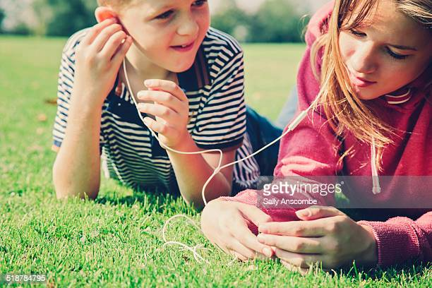 Children using a smart phone together