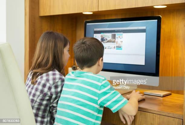 Children using computer together