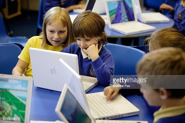 Children Using Laptops in Class