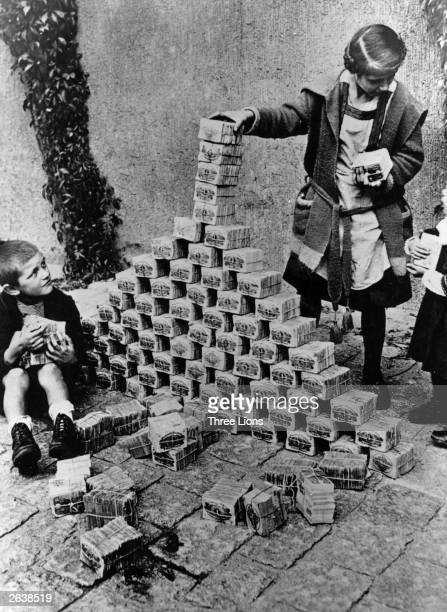 Children using notes of money as building blocks during the 1923 German inflation crisis