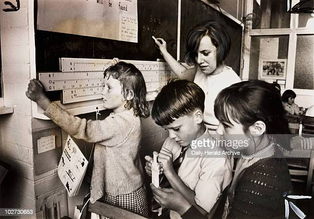Children using slide rules 1967 Photograph by Bob Hope for the Daily Herald newspaper showing children at St Leonard's School Warlingham Surrey One...