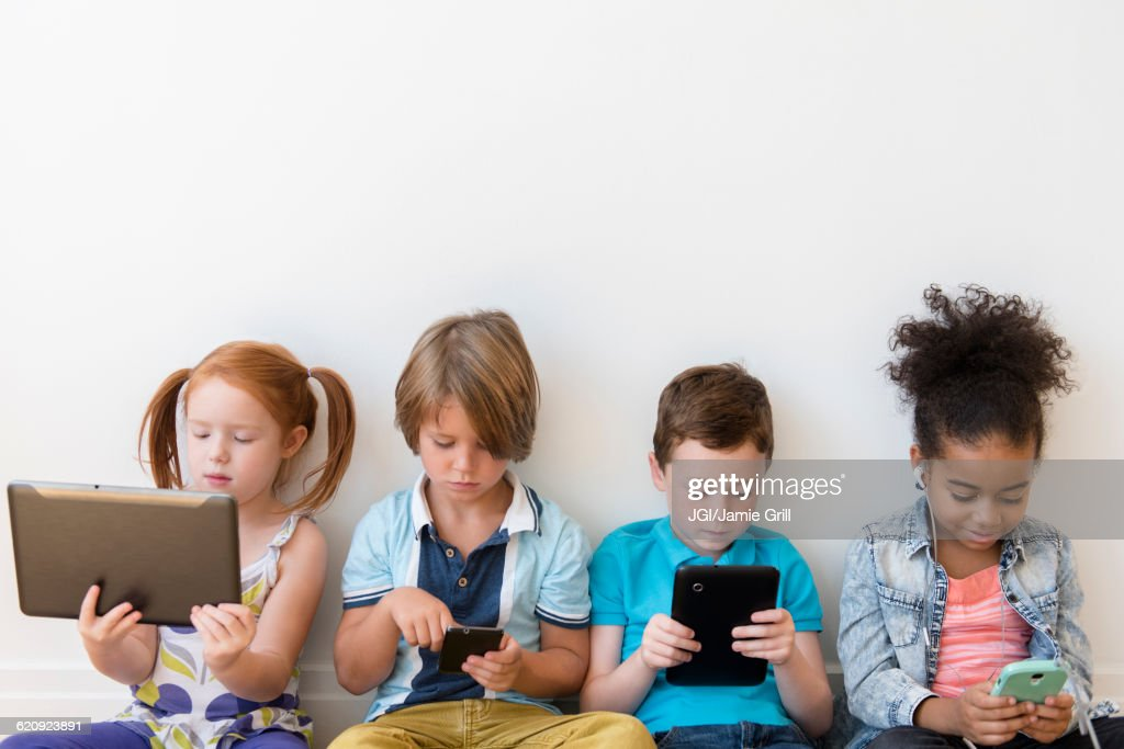 Children using technology : Stock Photo