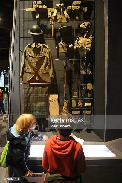 Children view an exhibit of WWI battlefield artifacts displayed at the In Flanders Fields Museum on November 7 2013 in Ypres Belgium 2014 will mark...