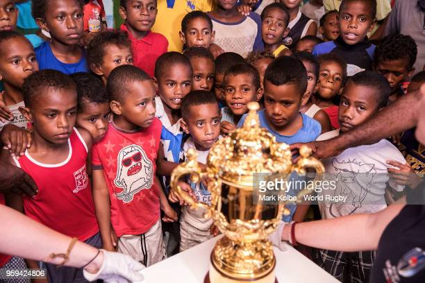 Children view the Webb Ellis Cup in the Galoa village hall during Rugby World Cup 2019 Trophy Tour on May 17 2018 in Galoa village Fiji