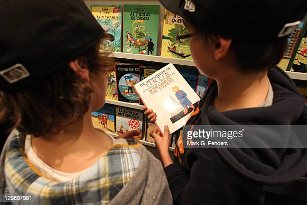 Children view Tintin comics on display at The Comics Village during the inauguration of the statue of comic hero Tintin by sculptor Nat Neujean on...