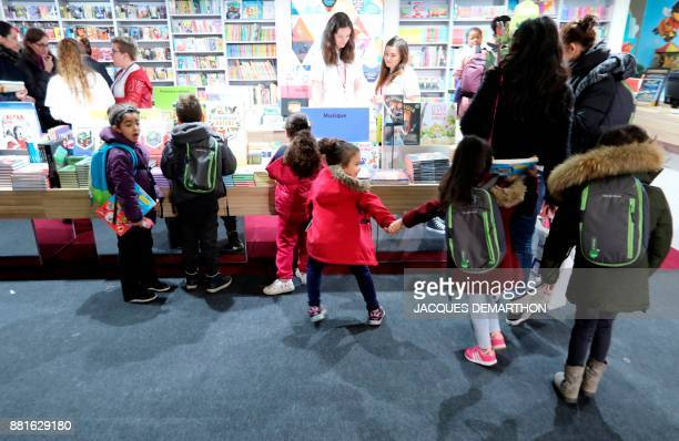 Children visit the Salon du livre et de la presse jeunesse in Montreuil eastern Paris on November 29 2017 DEMARTHON