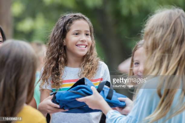 children volunteering at school supply donation drive at elementary school - donation box stock pictures, royalty-free photos & images
