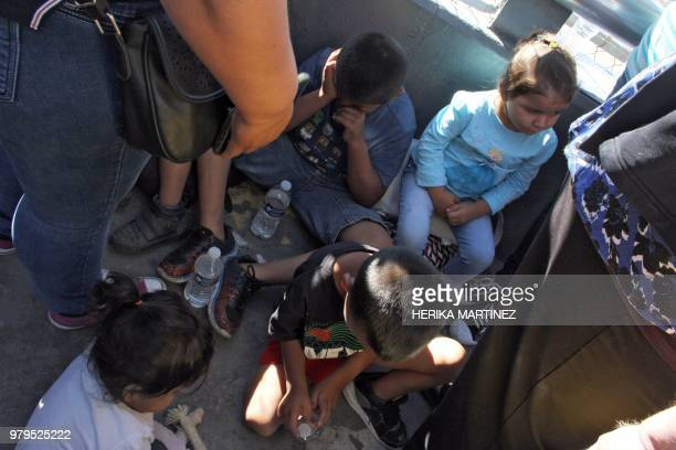 Children wait at the Paso Del Norte Port of Entry in the USMexico border in Chihuahua State Mexico on June 20 2018 US President Donald Trump said...