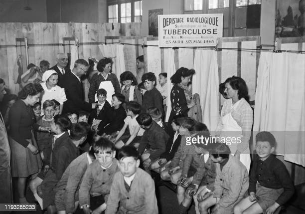 Children wait before having an xray radiography of the lungs during a tuberculosis screening operation on April 23 1945 in Montreuil