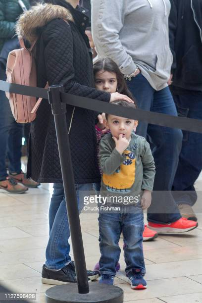 Children wait expectantly while on line with their mother to enter The Chocolate Expo at Garden State Plaza Mall Paramus New Jersey January 2019
