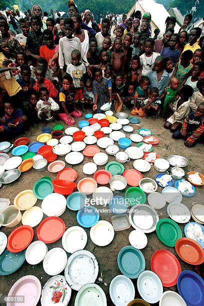 Children wait for food April 15 2000 in a transit camp in Chakuelane 200 km north of Maputo Mozambique The country was hit by severe floods in...