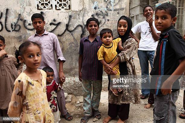 children wait for street school in lyari to start - pakistan stock pictures, royalty-free photos & images