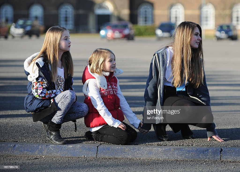 Children wait for their relatives to arrive home as soldiers from Headquarters Company 1st Battalion The Scots Guards return to their base at Bourlon Barracks and are reunited with their families following their recent deployment to Afghanistan on February 27, 2013 in Catterick, England. The soldiers are the first troops from 4 Mechanized Brigade to return to their base from their tour of duty in Afghanistan where they were responsible for the training and mentoring of the Afghan national security forces.