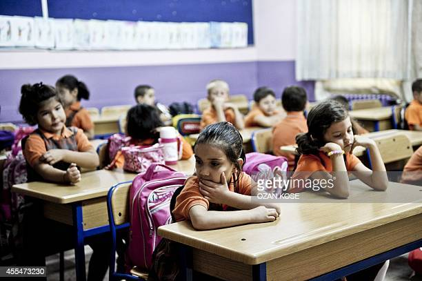 Children wait for their teacher on September 15 2014 on the first day of school at a primary school at Bayrampasa district in Istanbul More than 16...