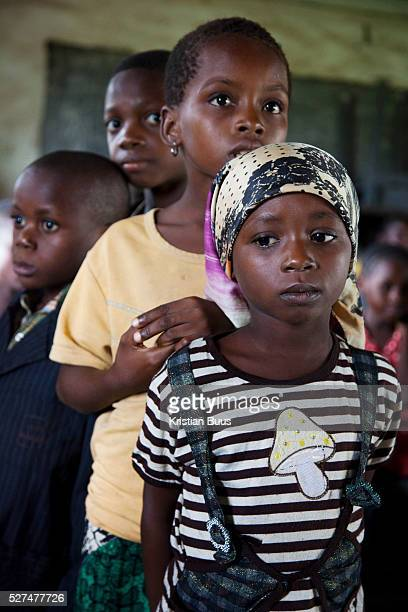 Children wait for their turn to be tested Volunteer Blessing and Doofan process the 120 children efficiently and kindly All tests proved negative EVA...