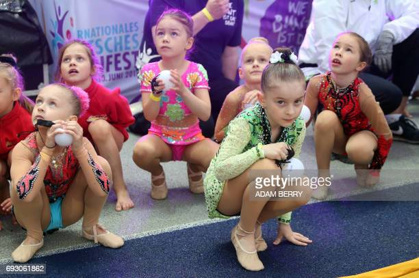 Children wait for their turn to perform at the Stadium Gala of the 2017 Deutsches Turnfest at the Olympic Stadium in Berlin on June 6 2017 / AFP...
