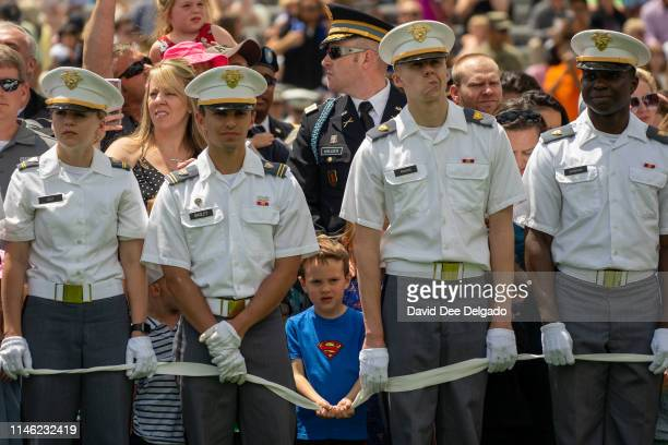 Children wait to collect hats of West Point graduates at the end of the U.S. Military Academy Class of 2019 graduation ceremony at Michie Stadium on...