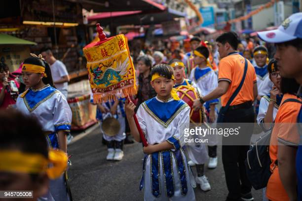 Children wait to march to Jenn Lann Temple in Dajia near Taichung as festivities begin to mark the nine day Mazu pilgrimage on April 13 2018 in...