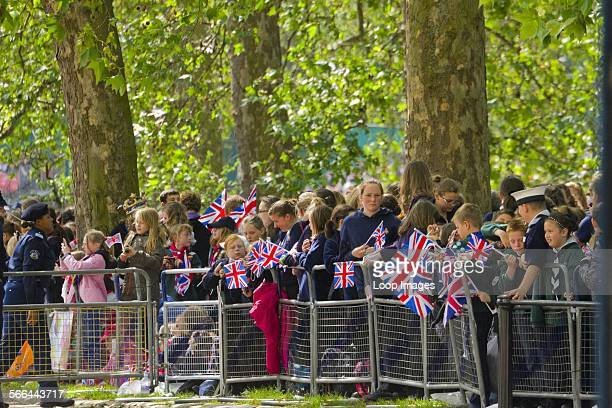 Children waiting to see the Regiments of Guards at the Trooping of the Colour.