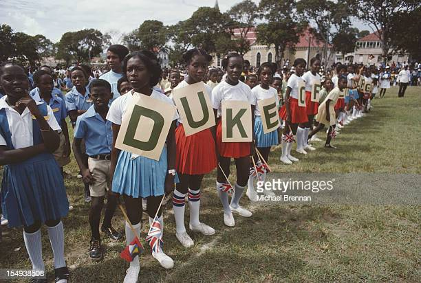 Children waiting to welcome Queen Elizabeth II and the Duke of Edinburgh to Antigua and Barbuda 28th October 1977