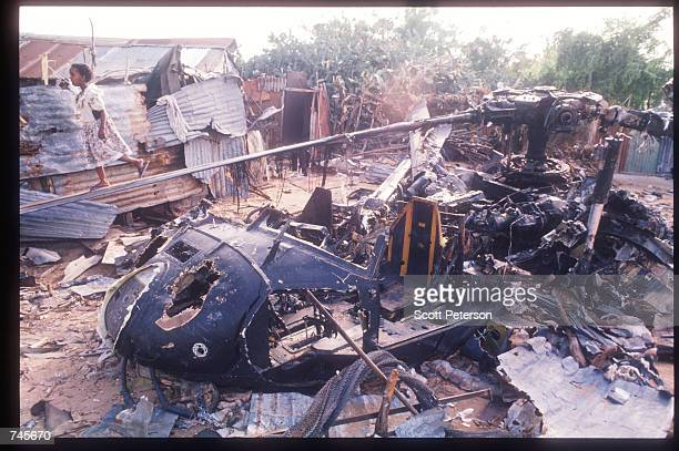 Children walk along the rotor of a wrecked American helicopter October 14 1993 in Mogadishu Somalia This Blackhawk helicopter which was used to root...