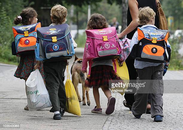 Children walk down the way on the first school day on August 23 2010 in Berlin Germany Many German school districts including those in Berlin are...