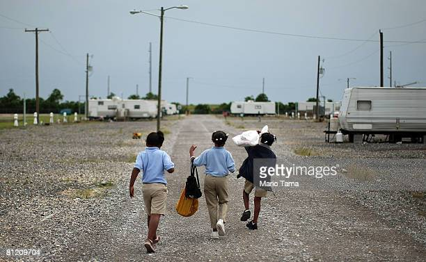 Children walk home after being dropped off by their schoolbus in the FEMA Diamond travel trailer park May 22, 2008 in Port Sulphur, Louisiana. FEMA...