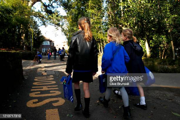 Children walk home from Altrincham CE aided primary school after the government's policy to close all schools from today due to the coronavirus...