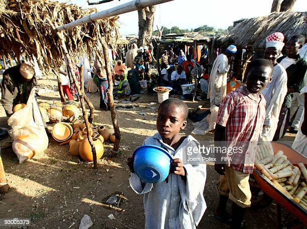 Children walk in a market on November 07 2009 in Bauchi Nigeria
